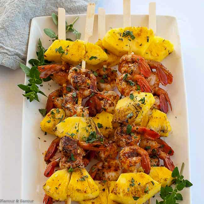 Grilleld Cajun Shrimp and Pineapple Kabobs on a white plate