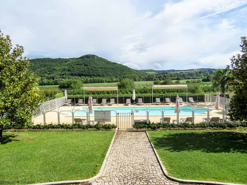 View of pool at Monrecour, a castle hotel in the Dordogne