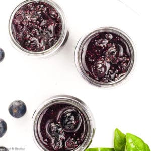 Overhead view of 3 jars of Blueberry Basil Chia see jam in small Mason jars