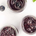 3 jars of Blueberry Basil Chia Seed Jam with fresh basil leaves