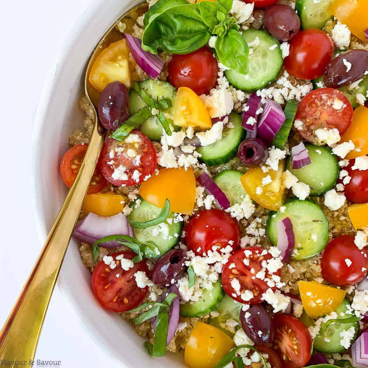 Close up view of Mediterranean Quinoa Salad with cucumbers, tomatoes, olives and feta cheese.