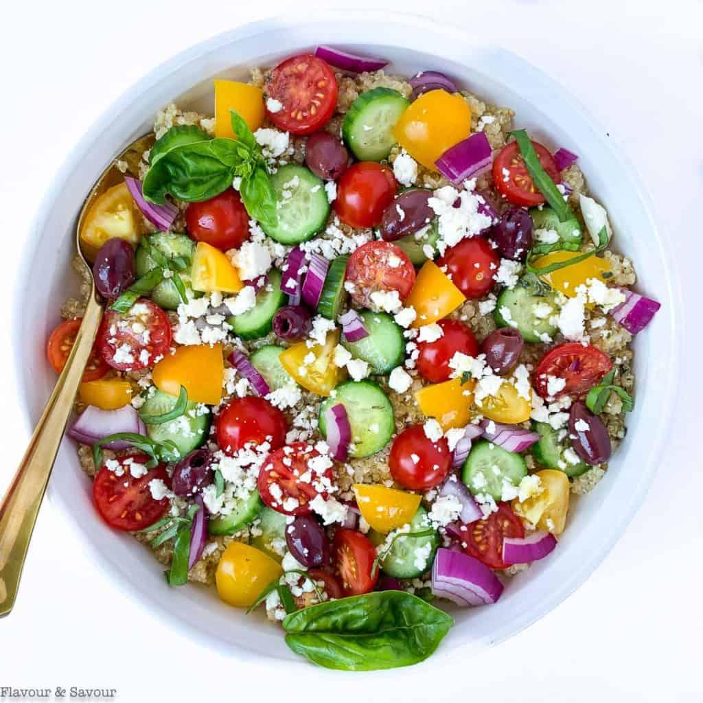 overhead view of Mediterranean Quinoa Salad in a round white shallow bowl
