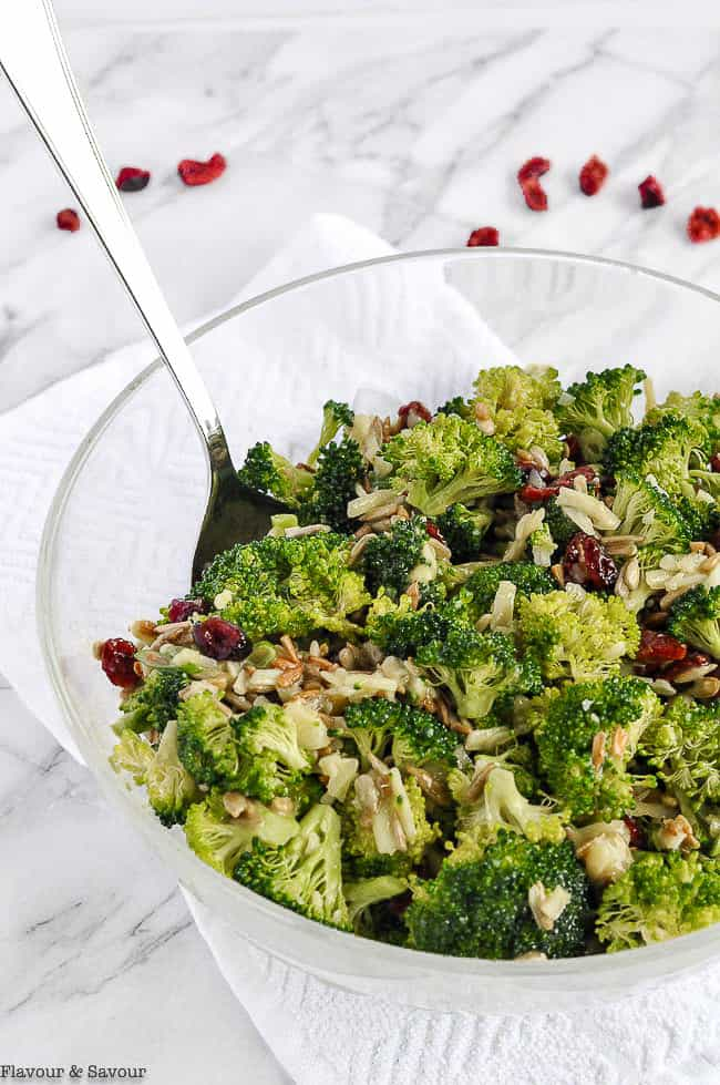 Broccoli Salad with cranberries in a glass bowl