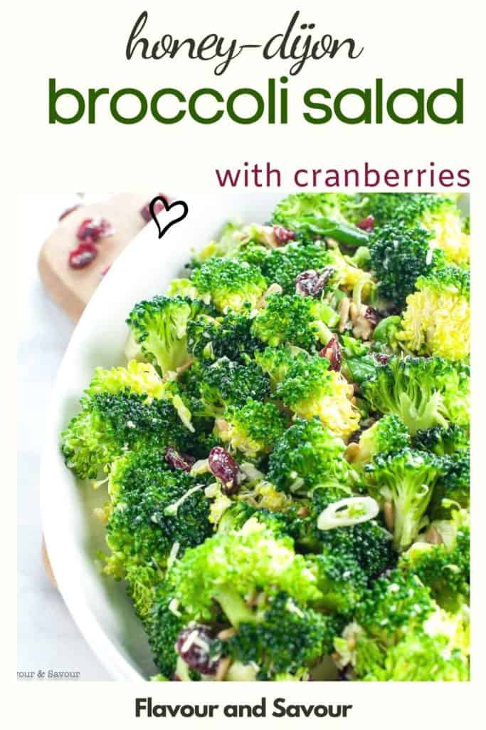 a bowl of broccoli salad with cranberries and sunflower seeds