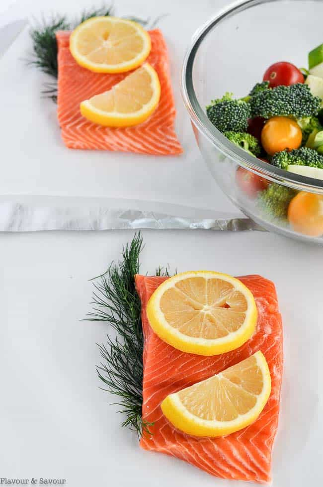 Preparing salmon for grilling in foil packets