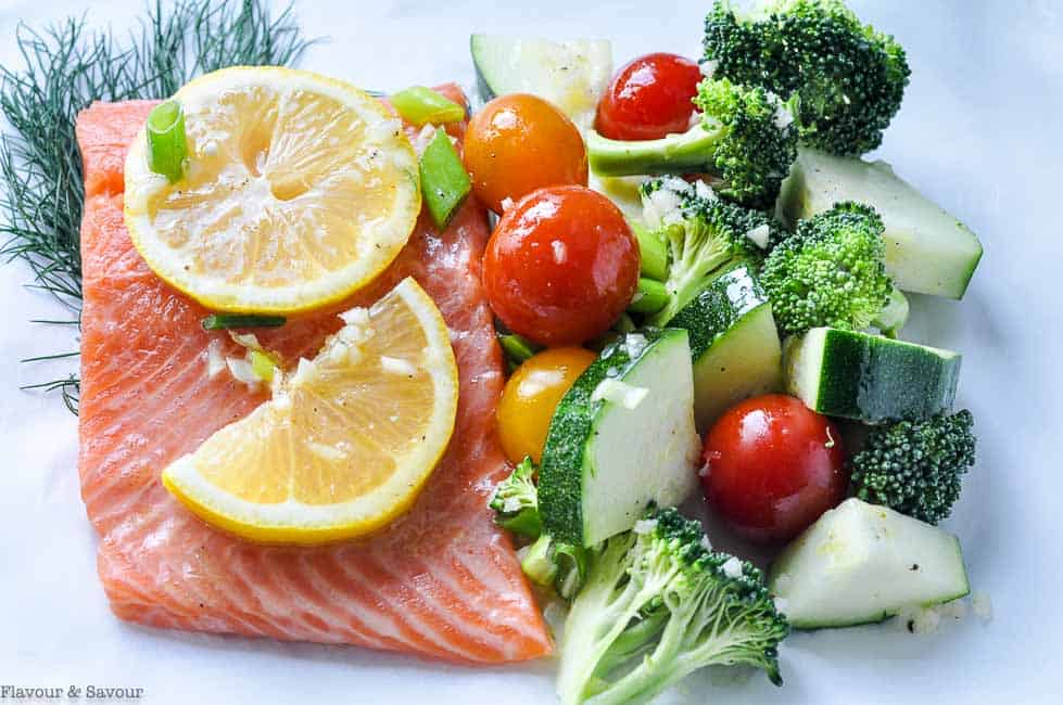 Preparing vegetables and salmon to cook in foil