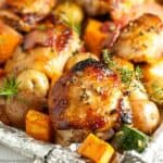 Roasted chicken thighs and vegetables on a sheet pan