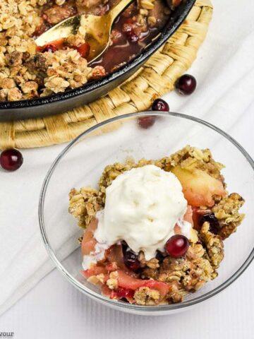 a bowl of Skillet Cranberry Apple Crisp