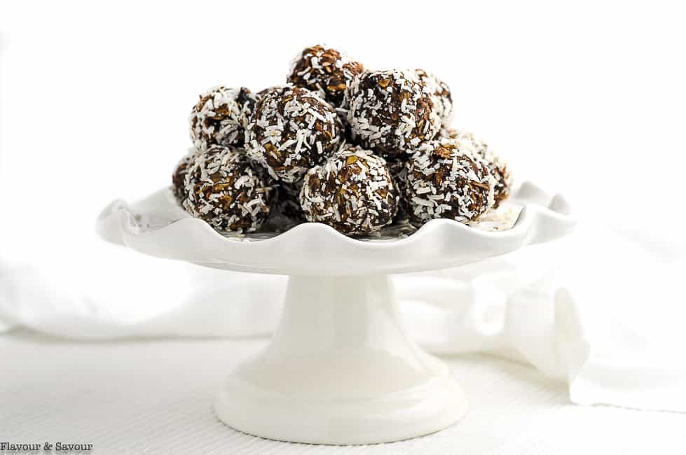 No bake Snowball cookies on a white pedestal