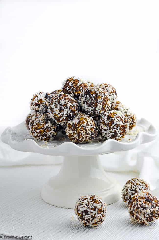 Chocolate Almond Snowballs on a white pedestal cake plate