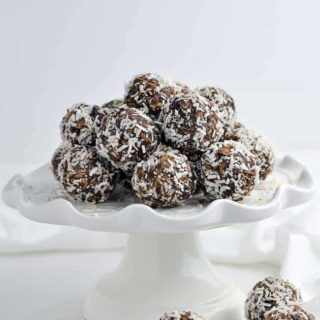 No Bake Chocolate Almond Snowballs on a white serving dish