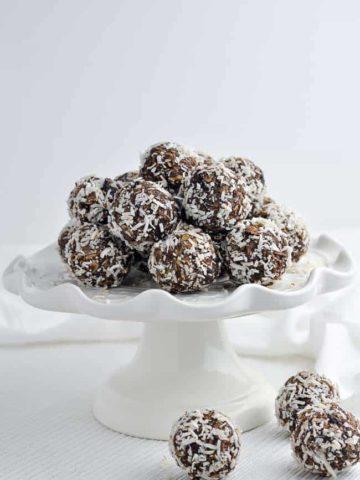 No Bake Chocolate Almond Snowballs on a white serving dish