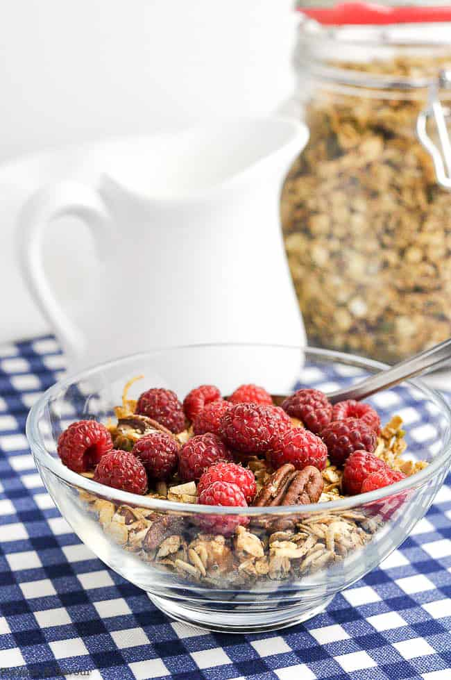 Pumpkin Spice Granola in a bowl with raspberries