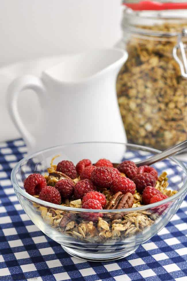 a bowl of Pumpkin Spice Granola with raspberries