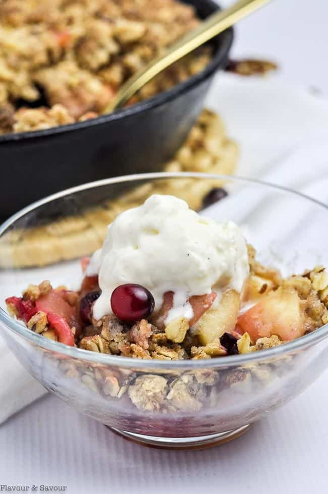 Skillet Cranberry Apple Crisp in a clear glass bowl