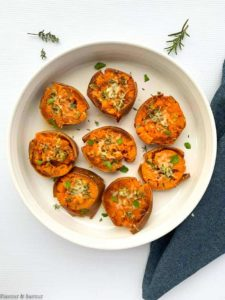 Rosemary Garlic Smashed Sweet Potatoes on a round white serving dish