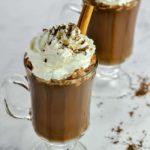 Two glass mugs of Cashew Milk Mexican Hot Chocolate