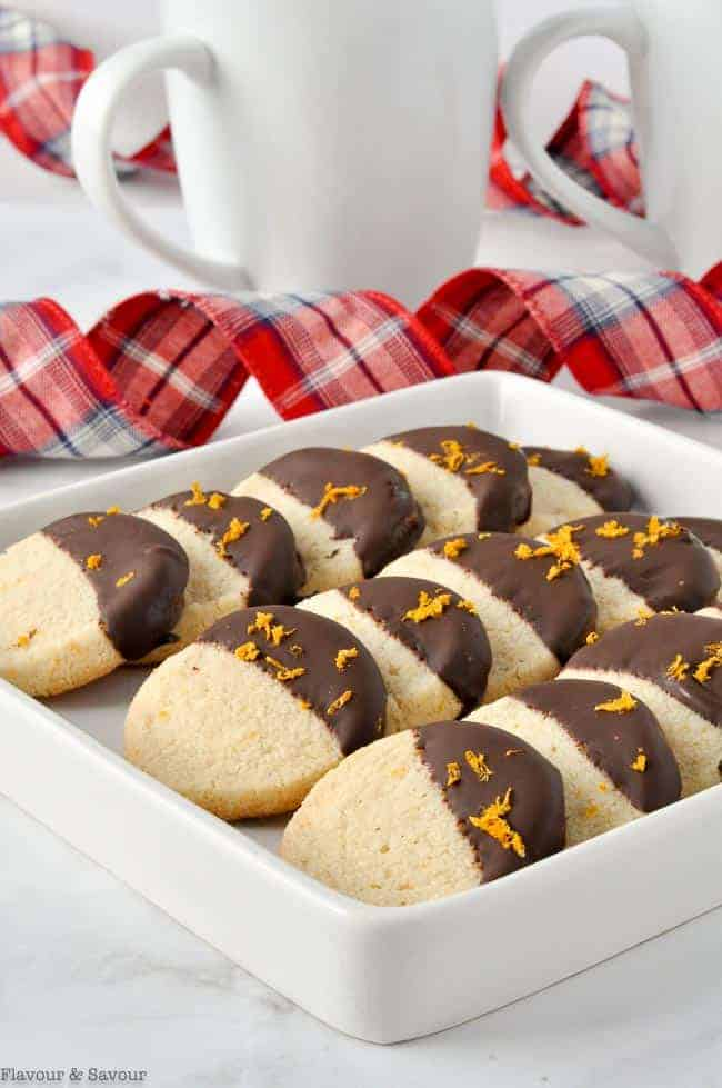 a square dish with 15 Chocolate Dipped shortbread cookies