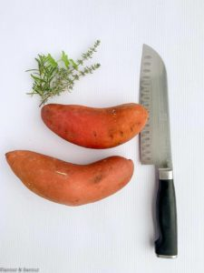 Two medium sweet potatoes and a knife