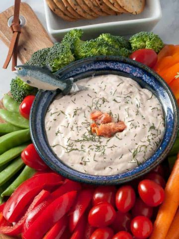 a blue bowl filled with smoked salmon dip