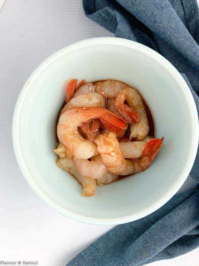 prawns marinating in a bowl