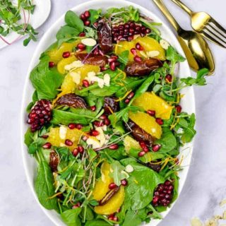 Spinach Salad with Oranges Dates and Pomegranate overhead view