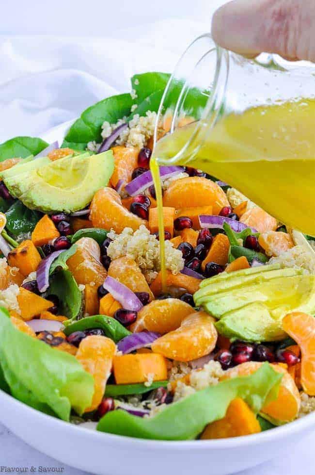 Pouring dressing on Sweet Potato Quinoa Salad