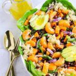 A bowl of Quinoa Salad with oranges and avocado