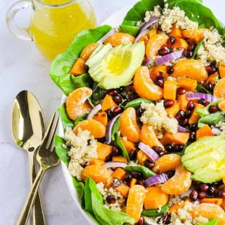 A bowl of Quinoa Salad with oranges and avocado