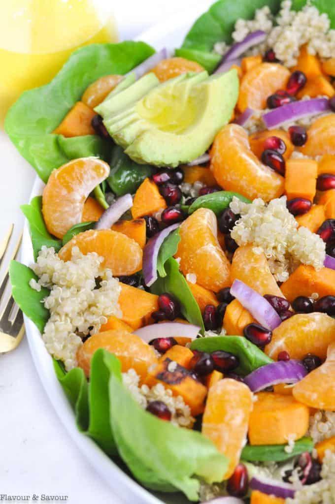 Close up view of sweet potato quinoa salad with avocado slices