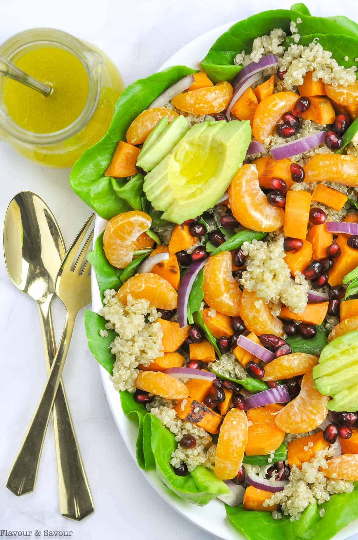 Sweet Potato Quinoa Salad with dressing and utensils