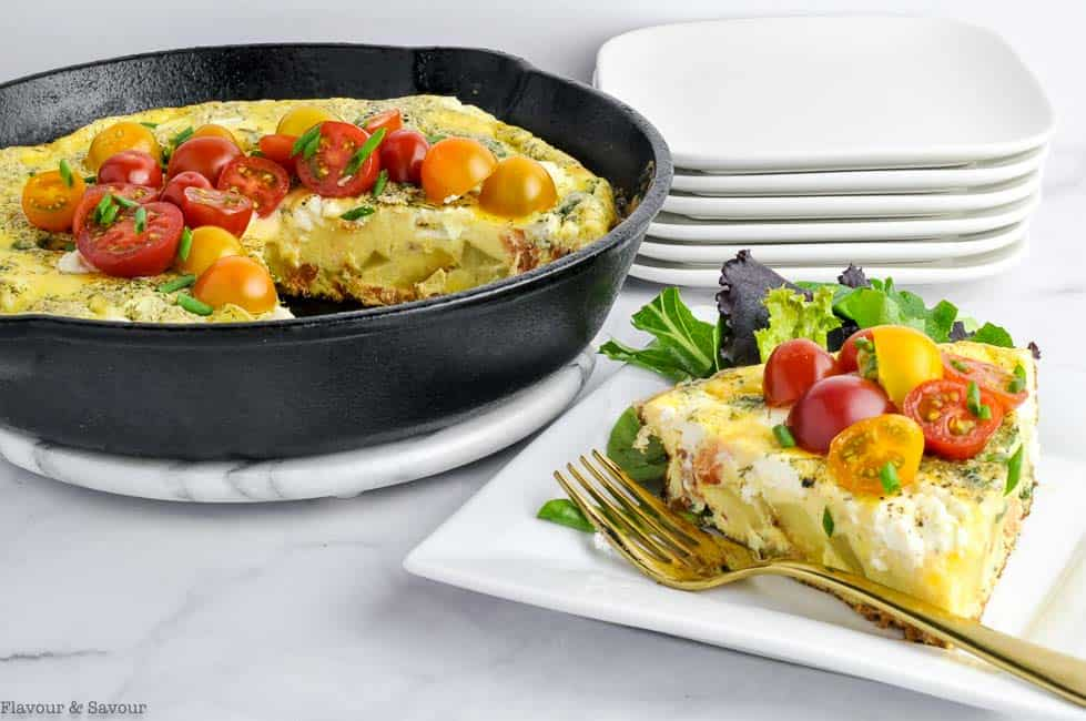 Frittata in skillet and wedge of frittata on a plate