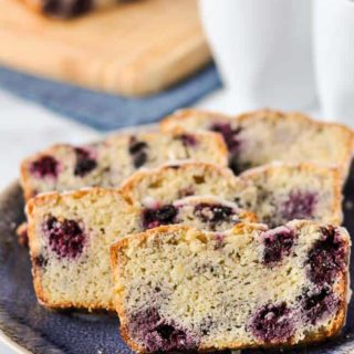 Slices of Blackberry Quick Bread with two coffee cups