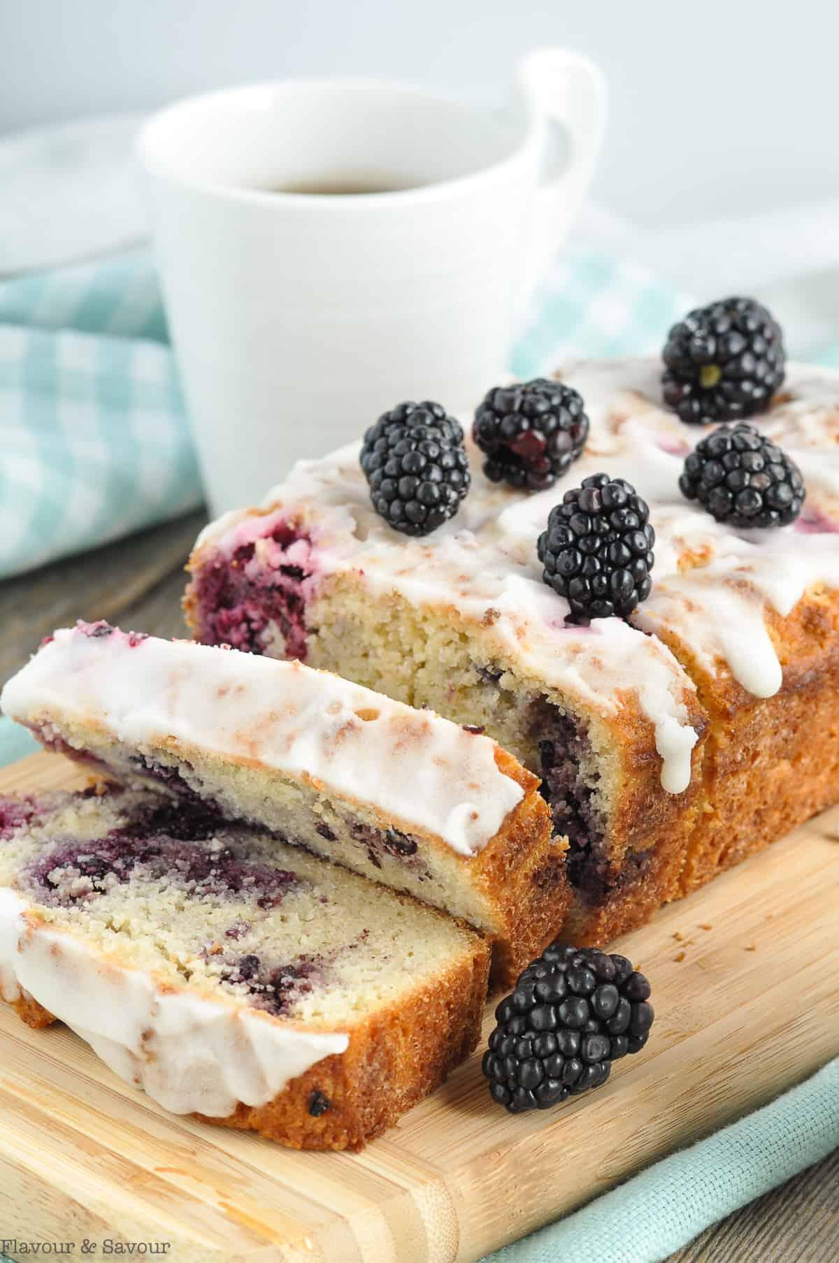 A sliced loaf of keto blackberry loaf.