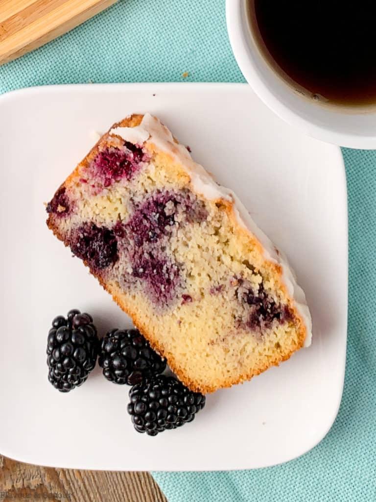 a single slice of Keto Blackberry Bread with fresh blackberries