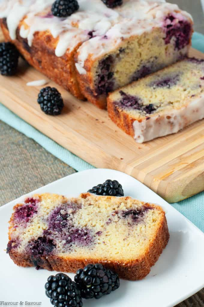 Keto blackberry loaf with a slice on a plate
