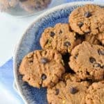 Almond Butter Chocolate Chip Cookies on a blue stoneware plate.