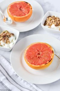 Broiled grapefruit halves with yogurt and granola cups on the side