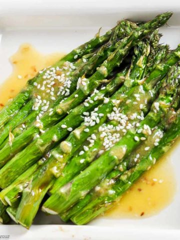 Roasted Asparagus with Sesame Miso Sauce on a square white dish