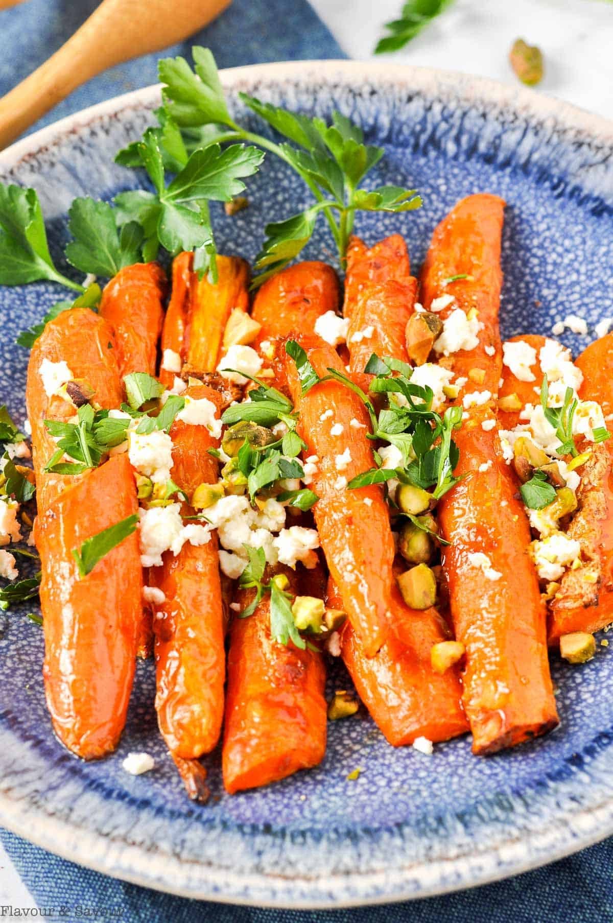 Air Fryer Roasted Carrots with Feta and Pistachios on a blue stoneware plate.