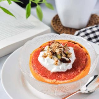 Broiled Grapefruit half topped with Greek yogurt and granola