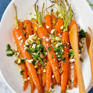 Roasted Carrots topped with Feta Cheese, pistachios and parsley
