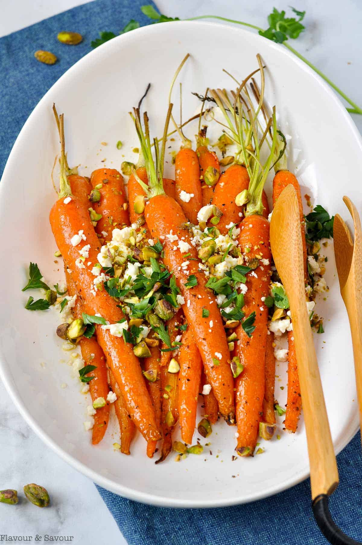 Whole Roasted Carrots sprinkled with feta, chopped pistachios and parsley.
