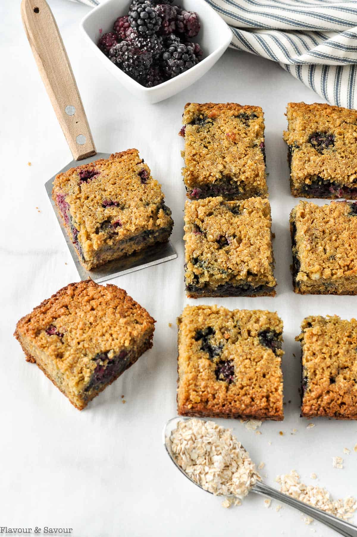 Overhead view of blackberry bars cut into squares.