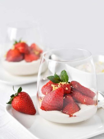 Macerated Balsamic Strawberries with cashew cream in a clear dessert glasses