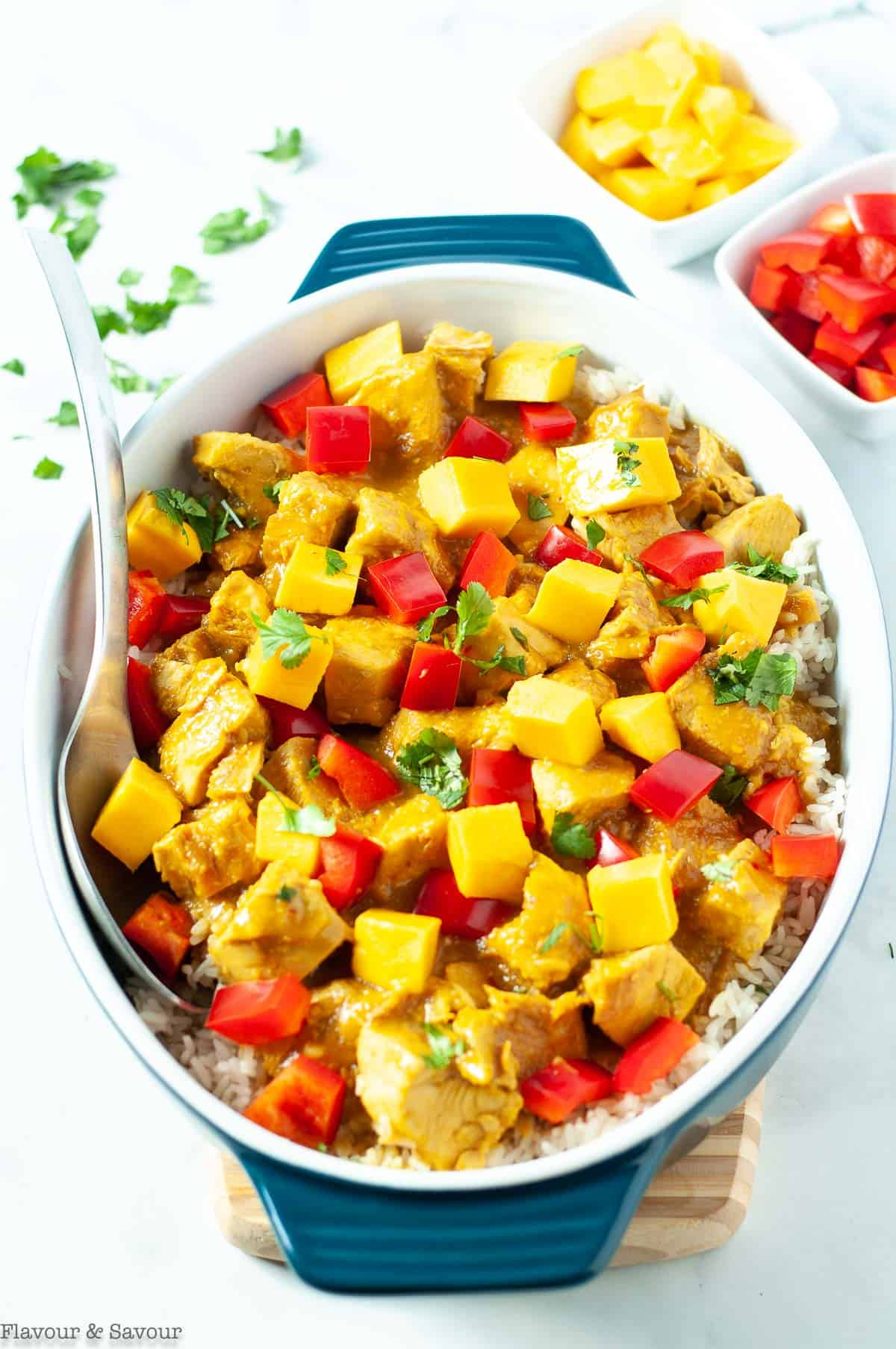 Thai Mango Chicken garnished with red pepper and diced mango.