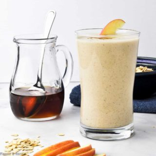 Apple Oatmeal Breakfast Smoothie with maple syrup and fresh apple slices