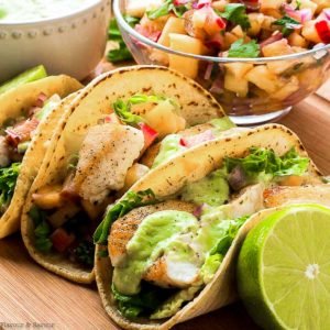 Fish Tacos with a bowl of pineapple rhubarb salsa