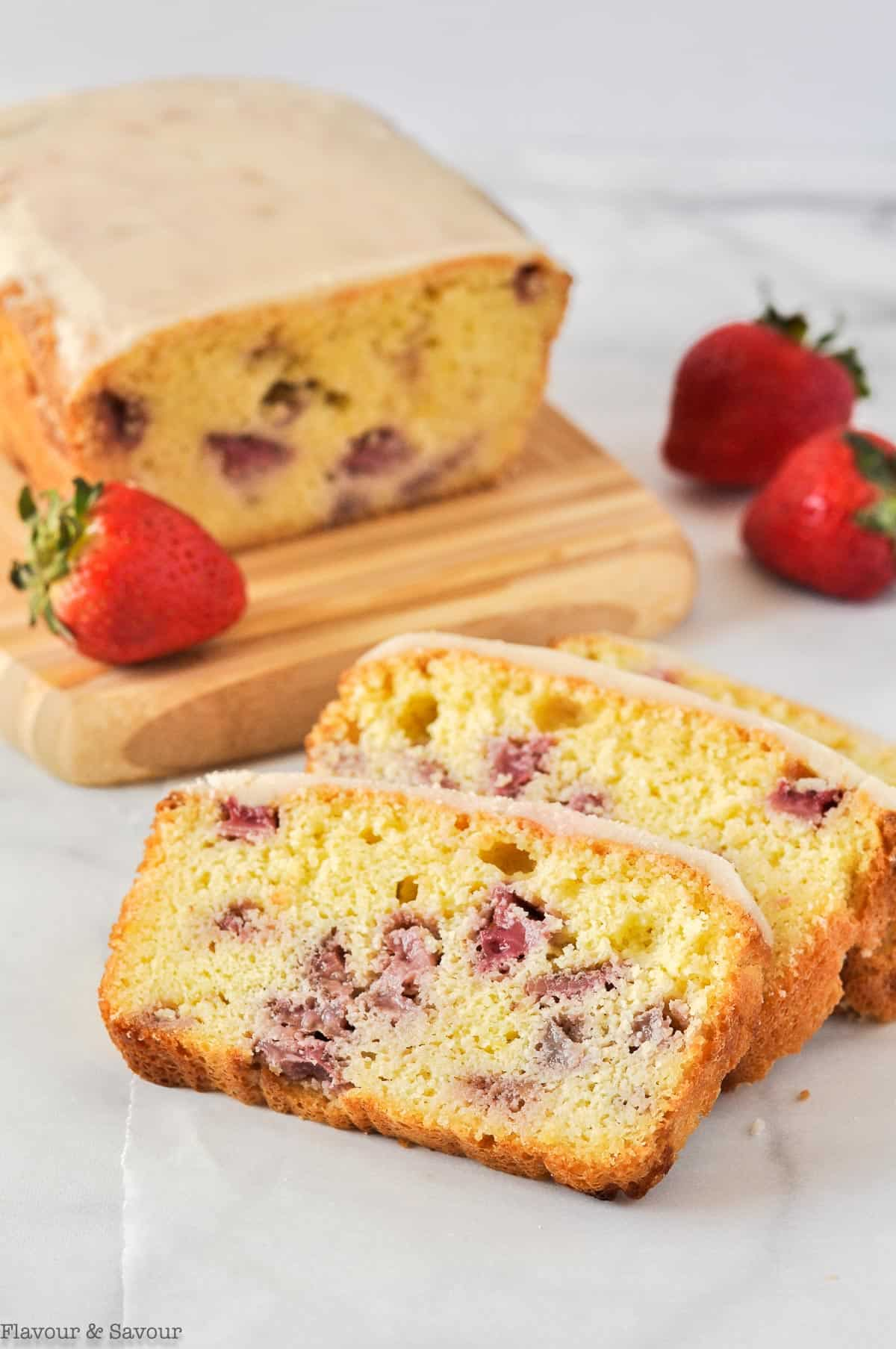 Strawberry Lemon Loaf sliced with fresh strawberries.