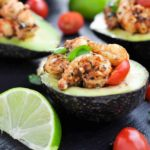 Close up view of Cajun Shrimp Stuffed Avocados with lime